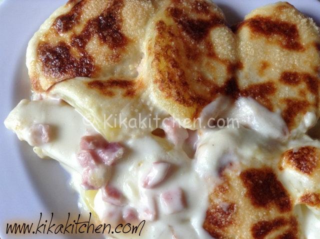 Patate gratinate con prosciutto e besciamella