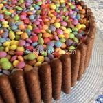 Torta smarties e togo con crema alla nutella
